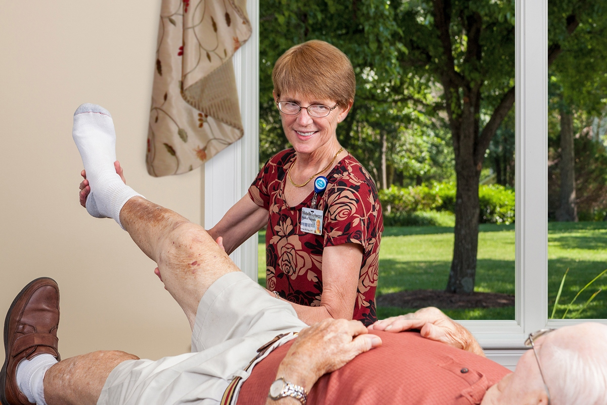 A nurse helps a patient with flexibility